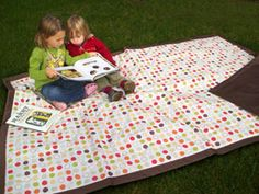 This popular, comfortable, water-resistant play mat is perfect for picnicking on the wet grass at the park, relaxing on the sand at the beach, or even giving your baby some floortime at home.  It's very lightweight, comes in a carrying tote with handles and unlike many other play mats out there, is big enough for several adults to sit on comfortably. Plus the price is right!