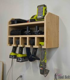 Cordless Drill Storage - Charging Station - Her Tool Belt Organize your tools, free plans for a DIY cordless drill storage and battery charging station.