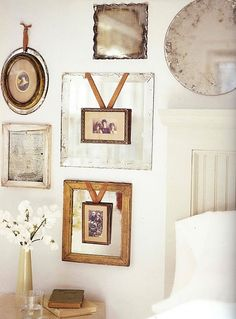 vintage mirrors, overlaid photos with a ribbon. I really like this layering, something i don't often think about with decorating.