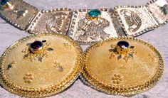 Traditional jewels from Sardinia (Italy). The pendant is usually worn with a velvet lace. The golden buttons are a typical adornment for the beautiful traditional sardinian dresses. Gioielli in oro