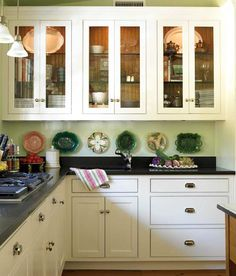 Black and white with celery green becomes a classic combination in an old house that had seen changes and additions over two centuries.