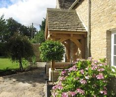 Oak porch listed building sat on a dwarf wall adding loads of character to this detached stone cottage. The seasoned oak adds shakes to the apprearance. Porch Oak, Porch Canopy, Cottage Front Doors, Manor Farm, Listed Building, Modern Door, Outdoor Areas, Pergola, House Styles