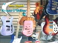 Conan O'brien head guitar. Not sure if its a real guitar or not but it gets Conan into the musical Instruments board. : )