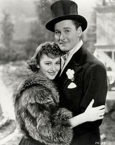 """Four's A Crowd"" 1938.  Errol Flynn and Olivia De Havilland"