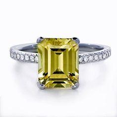 Emerald-cut chrysoberyl-and-diamond engagement ring