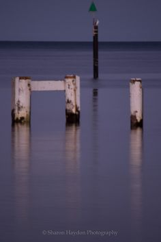 L1M2AP3 Depth. Using a slow shutter speed set at 2 sec at f/6.3 to capture the reflections on the water and add depth to the image. Focal length 250mm, ISO 200.