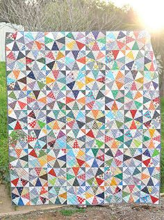 finished scrappy kaleidoscope quilt (with downloadable templates) from Kitchen Table Quilts