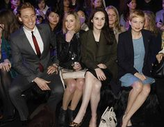 Tom Hiddleston, Laura Carmichael, Michelle Dockery (of Downton Abbey) and Michelle Williams at the Mulberry Autumn/Winter 2012 runway show during London Fashion Week at Claridge's Hotel on February 19, 2012 in London, England.