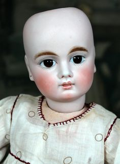 Sonneberg Bebe with Closed Mouth Early 8 Ball Body from signaturedolls on Ruby Lane