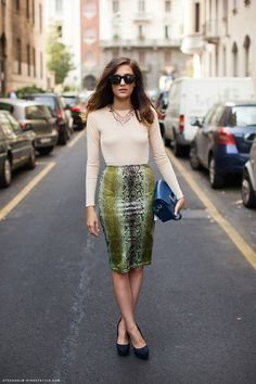 perhaps THE most perfect outfit ever! she hits every note; snake skin, neutral, pop of color, statement necklace....  I so want this outfit.
