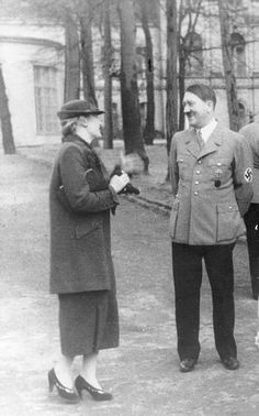 Magda Goebbels, desperately trying to get in with Hitler. As always, he's receptive but distant.
