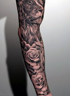Black And White Floral With Lion Head Tattoo On Man Full Sleeve