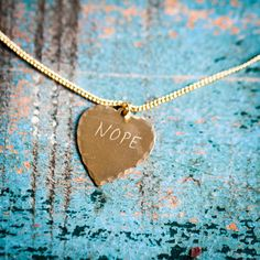 Classic sweet nothings speak for themselves, and these witty necklaces make for the perfect statement pieces. Each whimsical, hand engraved and individually hammered heart necklace from In God We Trust will live happily in your own personal collection for years to come.