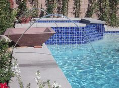 At night, these Pentair Laminars are multi-colored- matching the colored LED lights in the pool and spa
