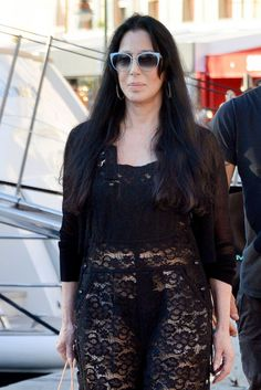 Cher wears a black lace outfit while walking in in St. Tropez, France, June 30, 2015.