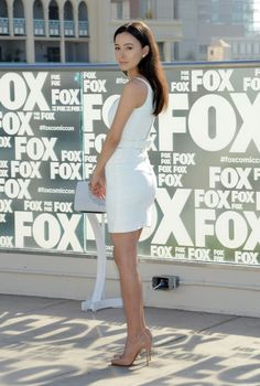 Christian Serratos lovely legs in white and ubiquitous nude Louboutins