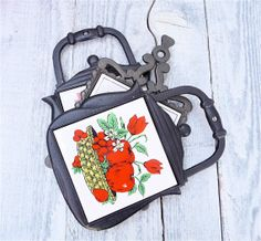 Strawberries and Apples on White Tiles in Black Cast Iron Trivets