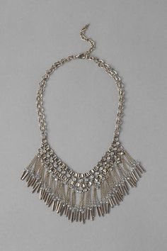 "Create+an+old+world+flair+with+the+Alexandria+Fringe+Necklace.+Strands+of+golden+fringe+hang+with+shimmering+crystals+from+a+stylish+link+chain.+Finished+with+a+lobster+claw+clasp.<br+/>  -+17""+length<br+/>  -+3""+extension<br+/>  -+Lead+&+nickel+free<br+/>  -+Imported"
