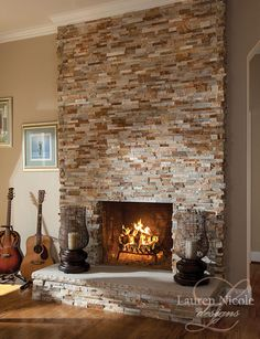 A glowing fireplace is the perfect backdrop for creating music in this family room #decor #interiordesign