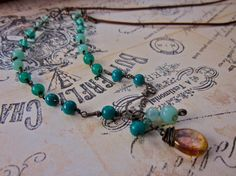 Check out this item in my Etsy shop https://www.etsy.com/listing/263158113/ombre-teal-linked-beads-long-charm