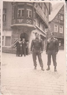 1st Infantry Division GIs in Germany, 1945. On the right you can see a Big Red One 1st Infantry Division patch and each is wearing the Fourragere awarded by France to members of the 1st Division for their D-Day landings and fighting in Normandy.
