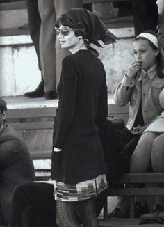 Audrey Hepburn Dotti in Rome during the Italian tennis championships at the Stadio dei Marmi, in September 1970. Audrey wears a long cardigan from Givenchy Nouvelle Boutique in navy blue, from the Autumn/Winter collection, 1969/70. Kerchief from the Givenchy Nouvelle Boutique. Stockings by Valentino.
