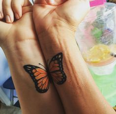 Mom and daughter got the Monarch butterfly to honor the family matriarch -- Grandma. Each has a full butterfly tattoo, but they can put them together like this. Love. http://thestir.cafemom.com/beauty_style/187679/21_mother_daughter_tattoos_that