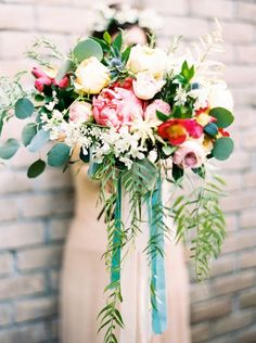 Pink and cream cascading bridal bouquet | Our Favorite Wedding Bouquets via @alowcountrywed
