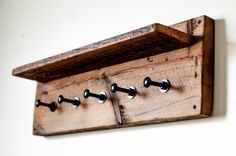 Rustic reclaimed wood coat rack/hanger with floating shelf and industrial carriage bolts used as hooks. Hand made from over century old barn