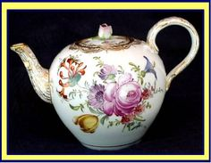 Antique Meissen china flowered teapot.