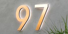 """Luxello Modern LED House Number 5 Outdoor : 5"""" brushed aluminium, architectural LED house number.  Made from a solid piece of aluminium that is machine finished with an anodized surface."""