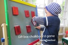Gift box chalkboard writing game for preschoolers! Preschool Rules, Preschool Activities, Teach Preschool, Writing Games, Writing Skills, Chalkboard Writing, Chalkboard Easel, Fun Drawing Games, Preschool Christmas