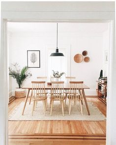 Who else is loving @thecuriousnatalia's dining room? 🙋 It's laid-back enough for takeout on a Friday, but classy enough for wine + a cheese board on a Saturday. Tap to shop our Clarence Dining Chair, then share your space with #itsallmodern.