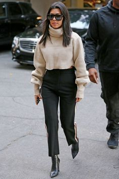 Kourtney Kardashian Wore a Cropped Sweater with the Track Pants You've Been Coveting | The reality star looked put-together in a short sweater and the track pants we've all been coveting. See her look.
