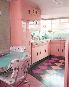 original pink 1950s kitchen with updated lino floors and starlite wall panels