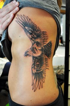american eagle tattoos for women | Tattoo of an eagle and Indian Face on a rib cage .