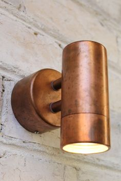Copper Pipe Wall Light has a copper finish