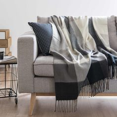 Discover a large selection of unique furniture and decorations at Maisons du Monde. Stylish sofas, wardrobes, storage units, lighting, seating and much more. White Throws, Unique Furniture, Soft Furnishings, Home Deco, Grey And White, Home Accessories, All About Time, Blanket, Pillows
