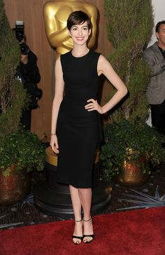 Anne Hathaway channeled Audrey Hepburn in this striking The Row little black dress at the Academy Awards Nominations Luncheon.
