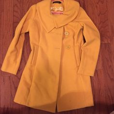 Yellow Winter Coat Yellow Winter Coat-shoulder to shoulder measurement is 17 inches. The size says large but it fits more like a medium. Jackets & Coats