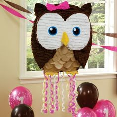 Owl+Pink+Pull-String+Pinata and lots of owl theme paper products for a baby shower.
