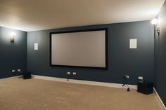 Same lovely house, different view. Home theatre space. Paint: Sherwin Williams' Outerspace SW Same lovely house, different view. Home theatre space. Home Theater Basement, Basement Movie Room, Movie Theater Rooms, Home Cinema Room, Home Theater Seating, Home Theater Design, Basement Ideas, Modern Basement, Home Theatre Rooms