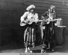 The lineage of New Orleans voodoo queens certainly does not end with Marie Laveau. Here's Lala, a 1930s voodoo queen, with her husband Louie, a couple of guitars, and her dog.  Image via Louisiana Digital Library