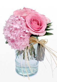 Roses and hydrangea in a mason jar with raffia - lovely the (band) hanging is different