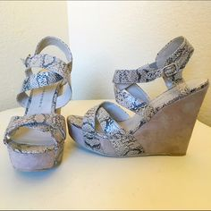 Chinese Laundry Taupe Snakeskin Print Wedge Heels Chinese Laundry Taupe Snakeskin Print Wedge Heel. Worn once. Strappy. 5 inch heel. 1 1/2 inch platform. Minor flaw on inside heel of one shoe. Flaw shown in last picture. Chinese Laundry Shoes Wedges
