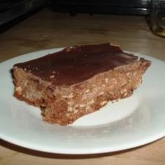 These flapjacks are a favourite in my household - filling, delicious and they couldn't be easier to make. Vary the recipe by adding cinnamon, ground ginger or different dried fruits. Golden Syrup Porridge, Porridge Oats, Chocolate Flapjacks, Flapjack Recipe, Melting Chocolate, Raisin, No Bake Cake, Baking Recipes, Cooking
