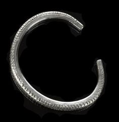 Bracelet (ring money) of silver, plain, part of Viking Age silver hoard found at Skaill, Sandwick, Orkney, deposited 950 - 970 AD.