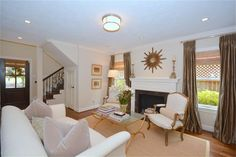 Living Room-hardwood floors, custom draperies, mock fireplace with custom mantel. Recessed and art lighting.