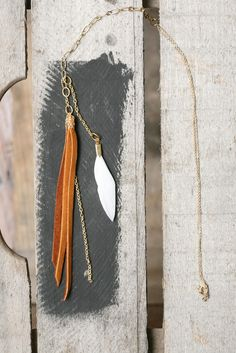 "Chocolate cinnamon spice - brown leather tassel necklace with white feather   new love.    6"" brown hand-cut deerskin tassel  white feather  5"" drop chain  http://www.etsy.com/listing/90377495/chocolate-cinnamon-spice-brown-leather"