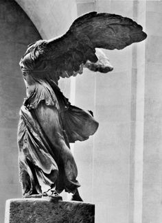 The famous Winged Victory, a mysterious and graceful figure due to her lost arms and head. The statue portrays the messenger goddess of victory, Nike. Her strong stance, wings, and flowing garments evoke a sense of triumph.